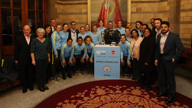 ALL SMILES: Everyone gathers for a snap with City's two trophies