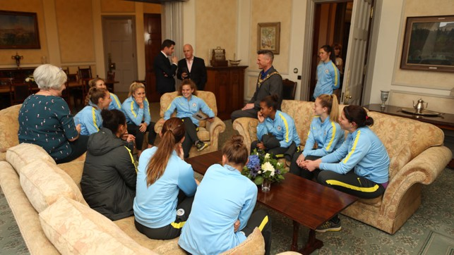 CLOSE-KNIT CIRCLE: The players chat with the Lord Mayor of Manchester, Councillor Carl Austin-Behan