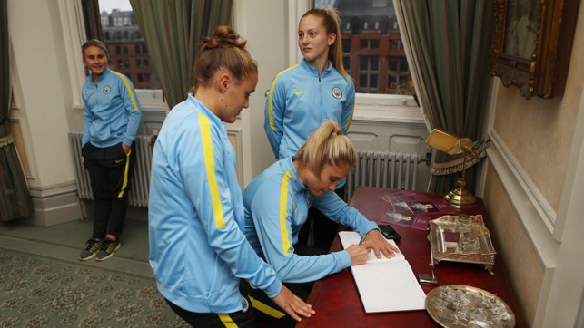 PEN TO PAPER: Steph Houghton signs the visitors book