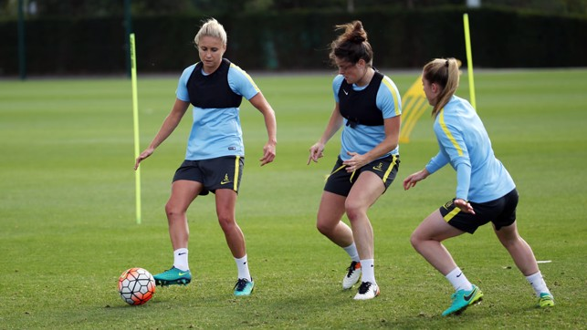 TOP TRIO: Steph Houghton plots her way past Jennifer Beattie and Keira Walsh