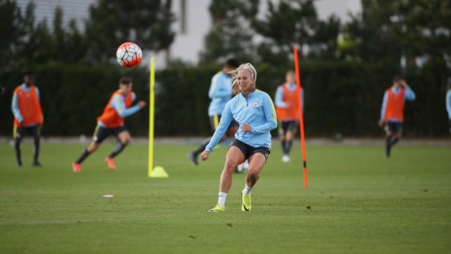 PING: Toni Duggan chips the ball across