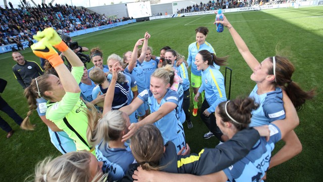 TOGETHER: The celebrations continue as the team huddle in celebration