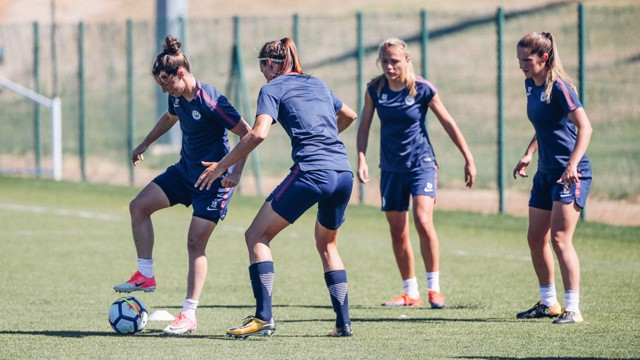 KEEP BALL: Jane Ross plots her next move, under the watchful eyes of Jill Scott, Claire Emslie and Abbie McManus