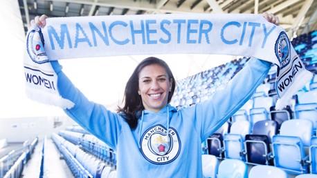 MANCHESTER PRIDE: Carli Lloyd proudly holds the Man City Women scarf aloft