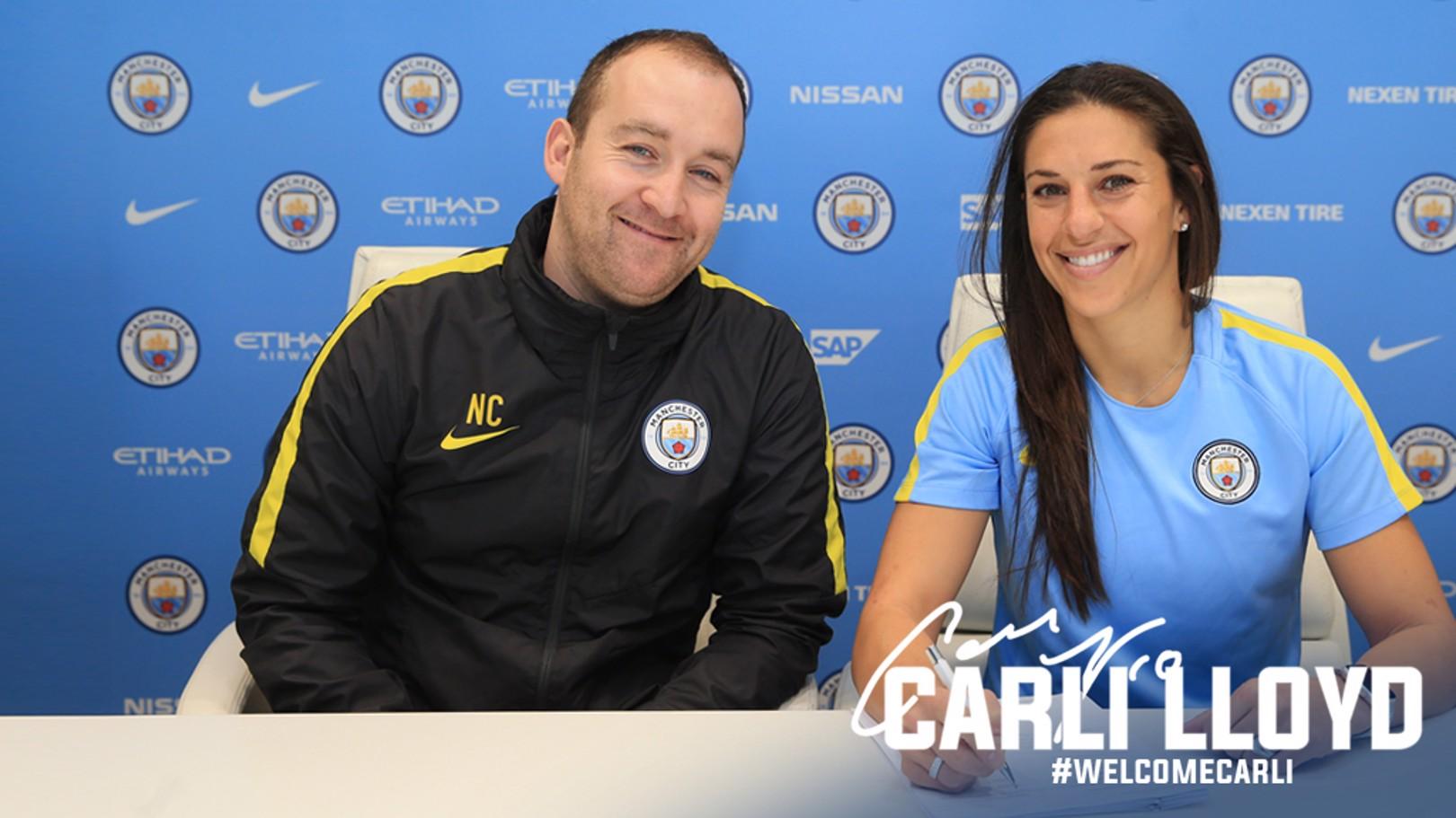 WELCOME CARLI: Carli Lloyd puts pen to paper alongside manager Nick Cushing