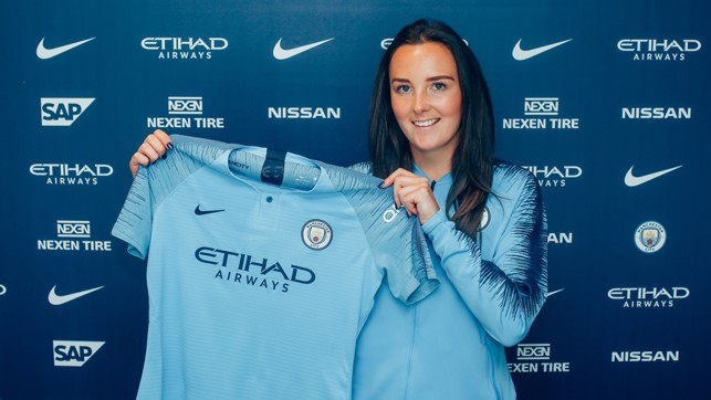 BEAMING: Weir proudly displays her new kit.