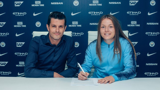 CONTRACT: Signing her contract with Head of Women's Football Gaven Makel.