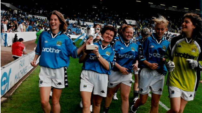 SHOWING OFF THE SILVERWARE: Parading our trophy around the Maine Road pitch