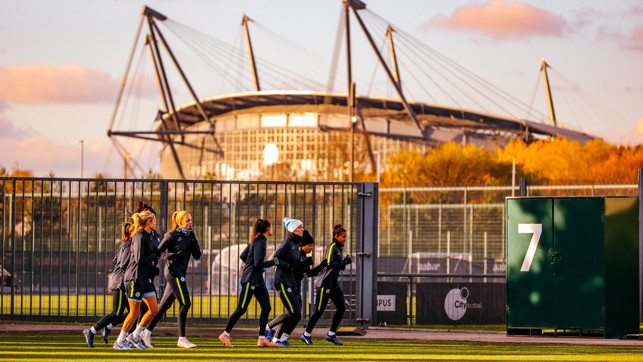 BACKDROP GOALS: The sun hits the Etihad Stadium in the background