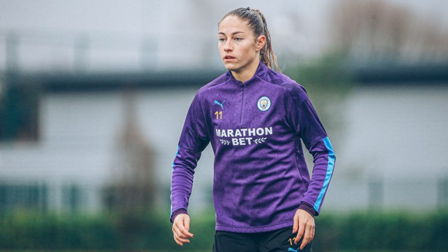 PURPLE REIGN: Janine Beckie shrugs off the rain as City hone their final preparations