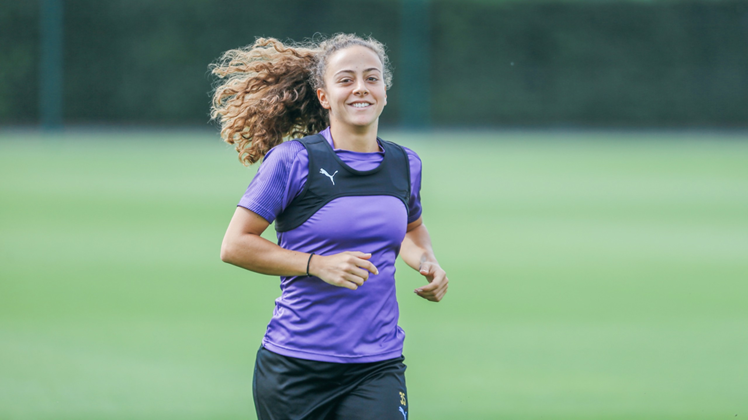 ALL SMILES: The Portuguese midfielder looks delighted at getting into the swing of things at City