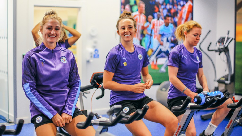 RIDING HIGH: All smiles on the fitness bikes