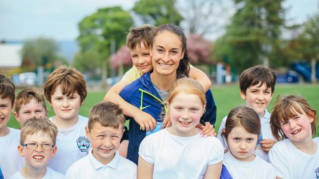 SMILES: The kids enjoyed practising their football skills with Tess