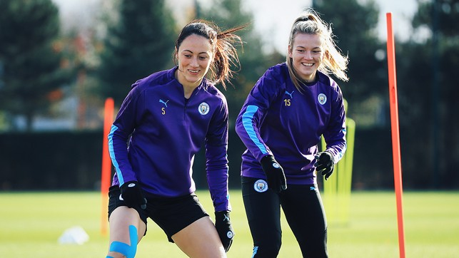 ON THE MOVE: Megan Campbell and Lauren Hemp limber up ahead of the West Ham clash
