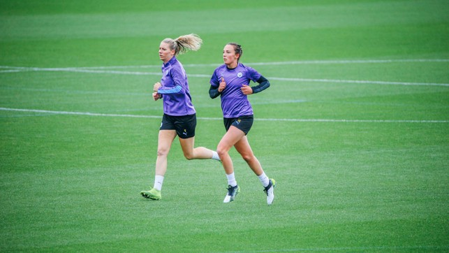 ON THE RUN: Gemma Bonner and Caroline Weir put in the hard yards
