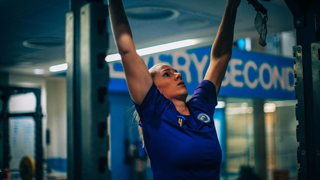 REACH FOR THE SKY: Gemma Bonner tests her upper body strength