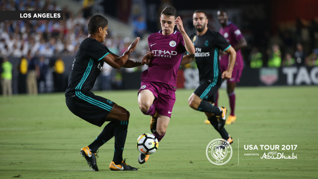 THROUGH THE MIDDLE: Phil Foden avoids traffic