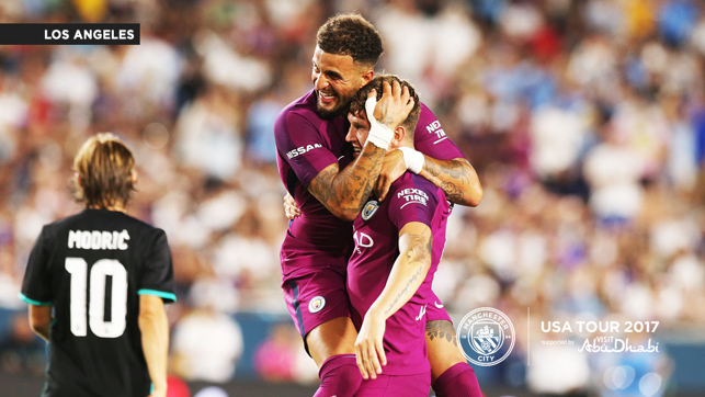 HUGS: Kyle Walker and John Stones celebrate a big win