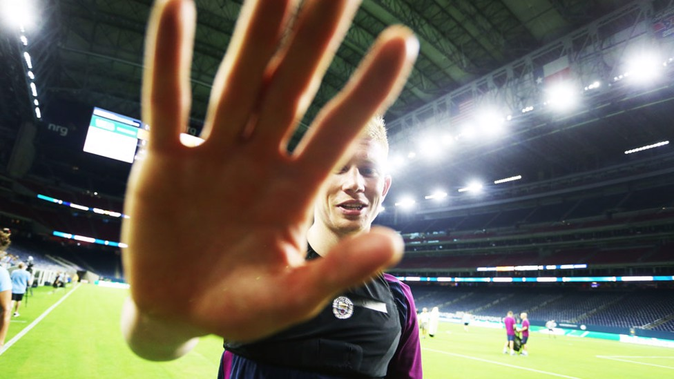 SHYNESS IS NICE: KDB doesn't want the camera on him!