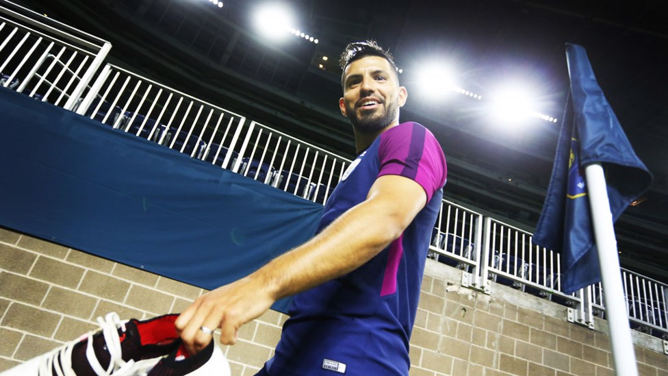 DONE FOR THE DAY: Aguero leaves the field looking pleased with his efforts