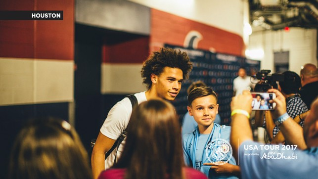PICTURE PERFECT: A special moment for a young fan.