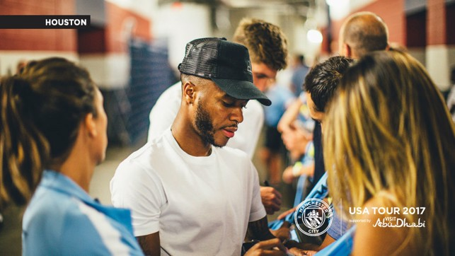 STERLING WORK: Raheem making a City shirt even more special with his signature.