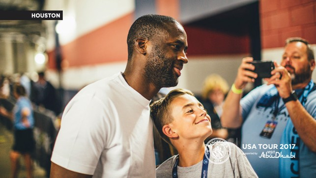 JUNIOR BLUE: Yaya makes one young fan very happy.