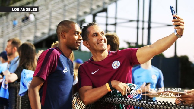 FAN PHOTO: Fernandinho meets fans at the end of the open training session.