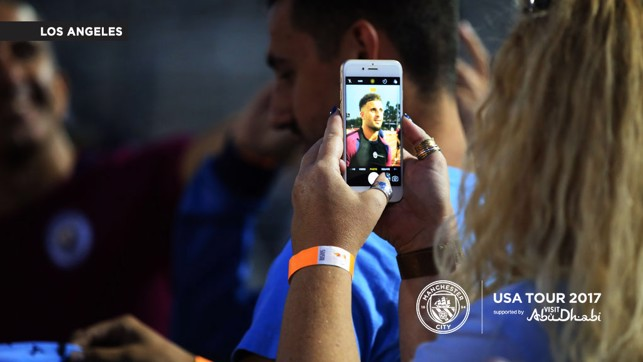 A PHOTO IN A PHOTO: A fan takes a snap of Kyle Walker.