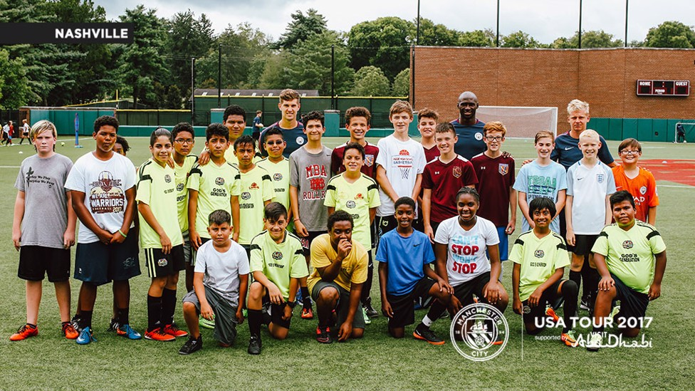 GROUP SHOT: Stones, Mangala and Zinchenko pose with some of the kids.