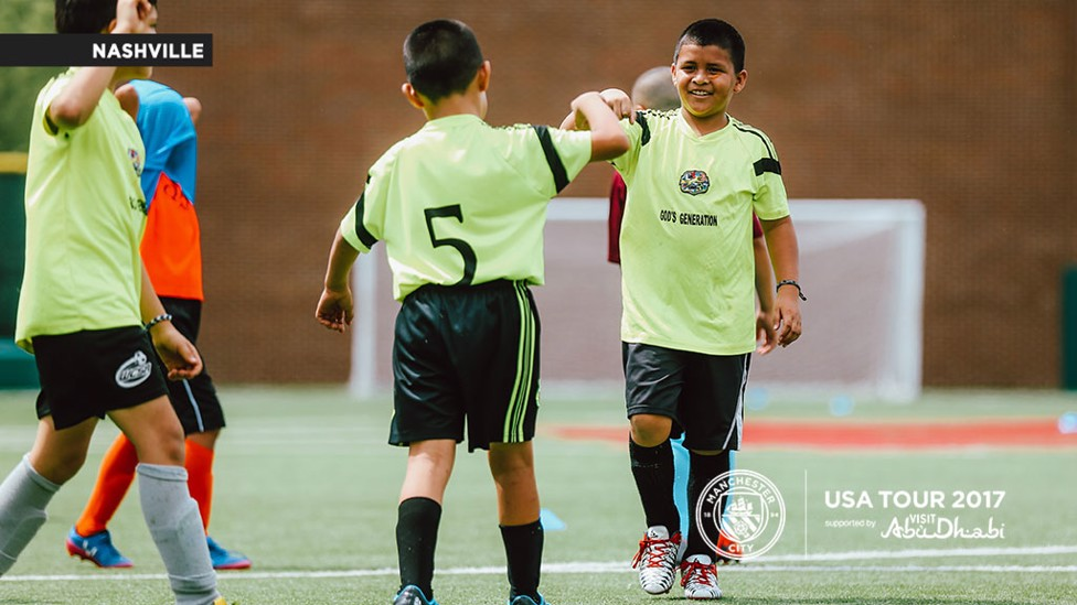 FIST BUMP: These two youngsters celebrate during the session.