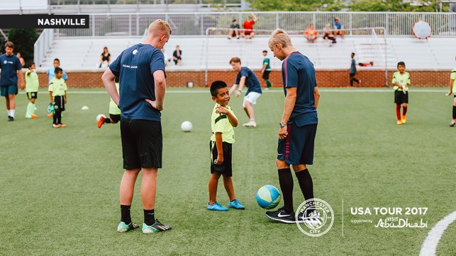 CHATTING AWAY: Oleksandr Zinchenko speaks to one of the youngsters.