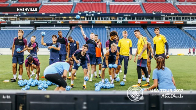 GIFTS: The squad start to throw out City footballs at the end of the session.