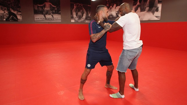LONG SHOT: Another angle of Otamendi and Manuwa locking up.