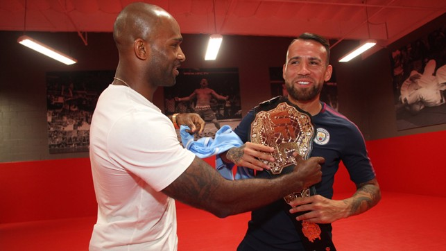 HERE YOU GO: Nico gets hold of the UFC replica belt.