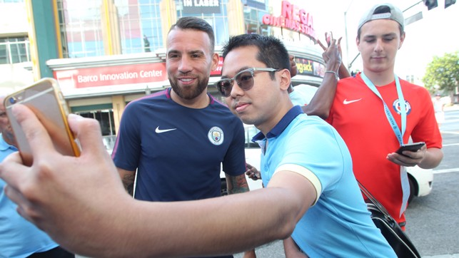 SELFIE TIME: Nico poses with a fan outside the venue.