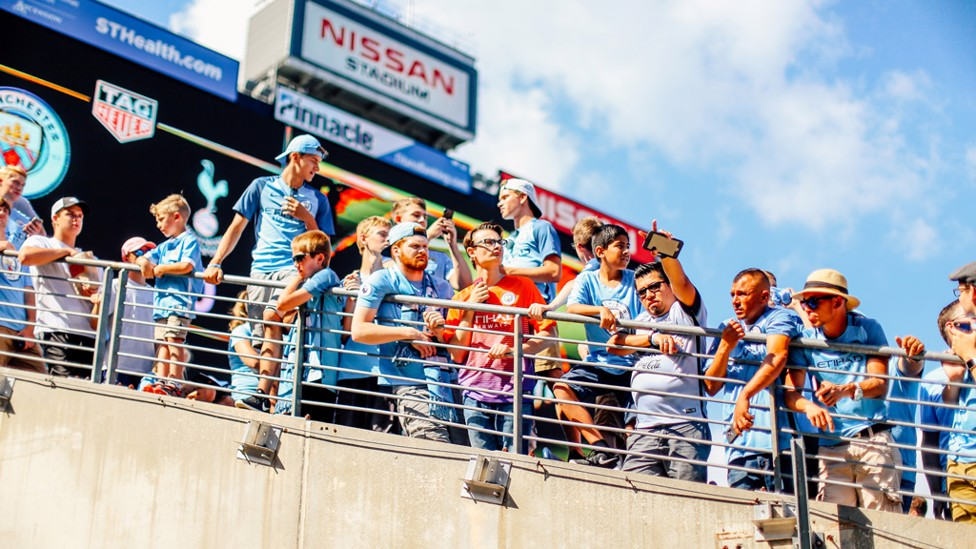 TUNNEL VISION: City fans hang over the Nissan Stadium players' entrance