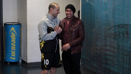 ...to see you...Martin Petrov says hello to old mucker Nigel de Jong.