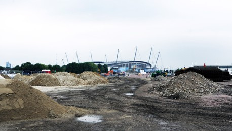 The Etihad Stadium towers above the building site