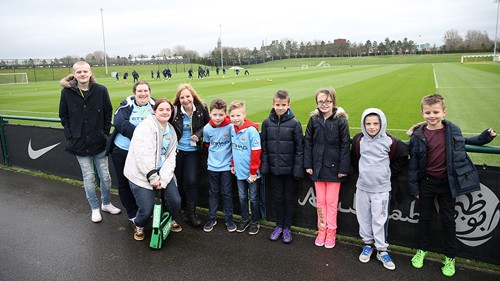 Manchester City fans enjoy watching the players train