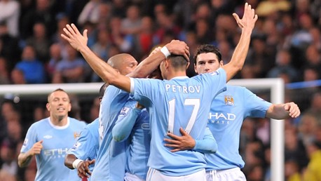 Petrov celebrates the second goal with team mates at City vs West Ham