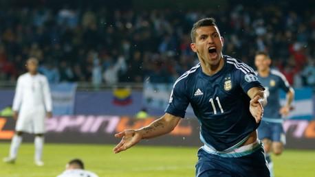 Sergio Aguero scores against Uruguay