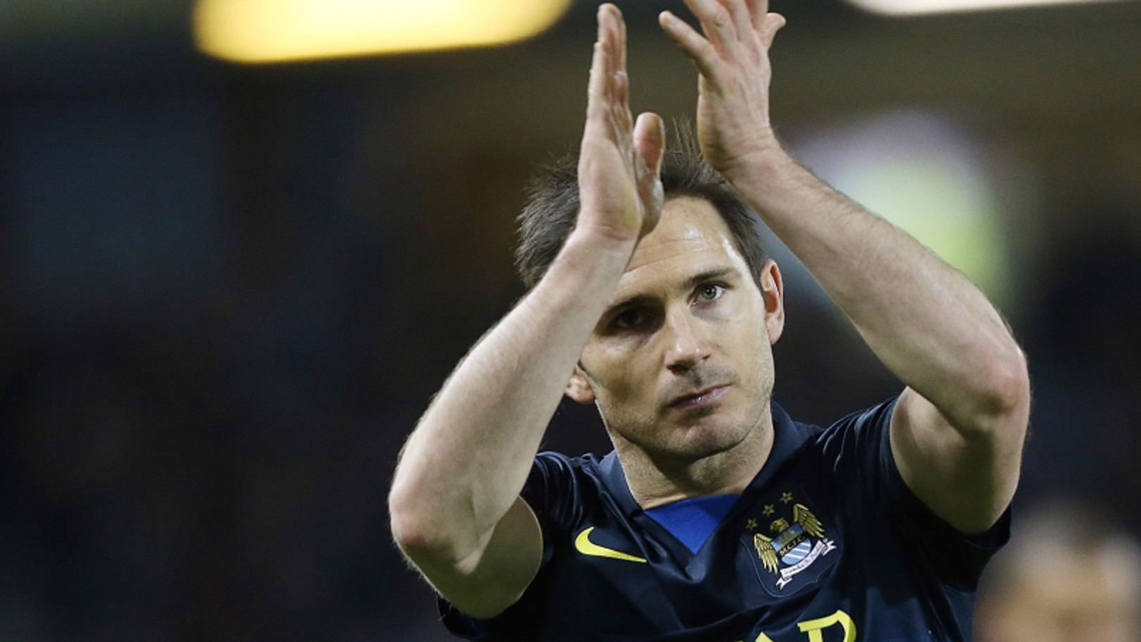 Manchester City's Frank Lampard applauds the City fans at the end of game