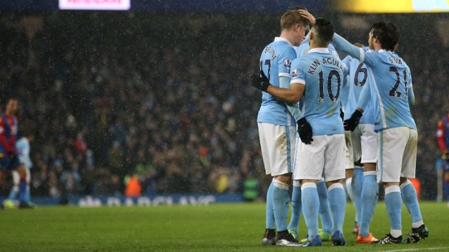 Manchester City players celebrate the fourth goal
