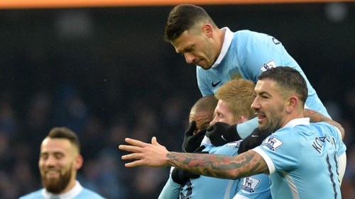 Manchester City players celebrate the opening goal