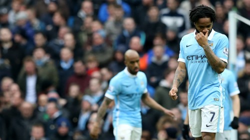 Raheem Sterling appears dejected after Leicester's third goal