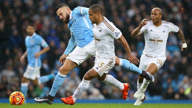 Nicolas Otamendi and Wayne Routledge battle for possession