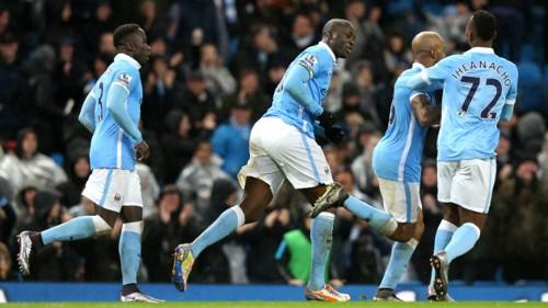 Bacary Sagna, Yaya Toure, Fabian Delph and Kelechi Iheanacho celebrate Manchester City's winning goal