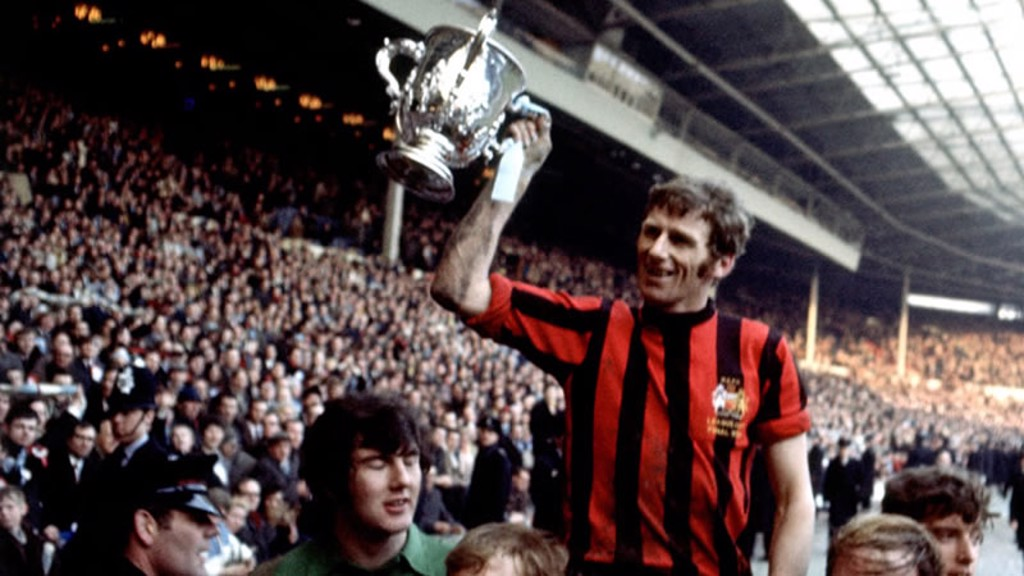 1970 LEAGUE CUP: Skip shows the trophy to the City fans