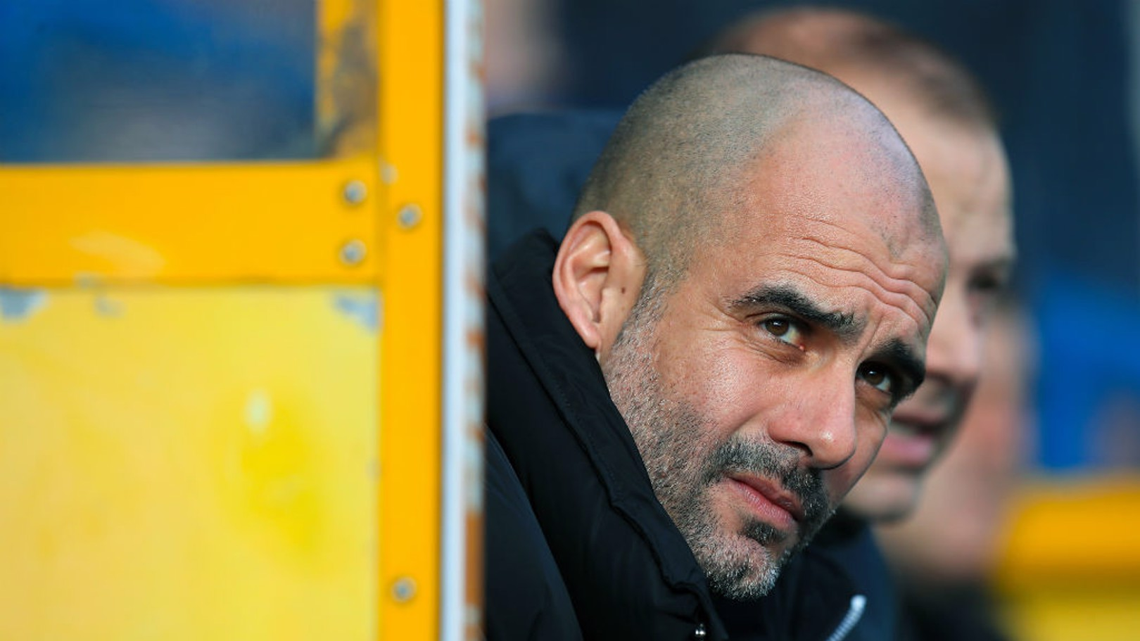 PONDEROUS: Pep takes his seat in the dugout